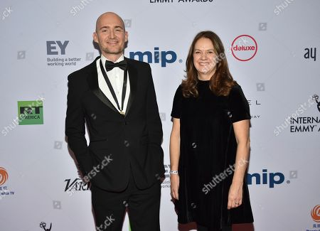 James Watkins, Dixie Linder. Executive producer/writer/director James Watkins, left, and executive producer Dixie Linder attend the 47th International Emmy Awards gala at the Hilton New York, in New York
