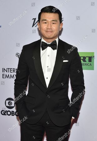 Ronny Chieng arrives at the 47th International Emmy Awards gala at the Hilton Hotel, in New York