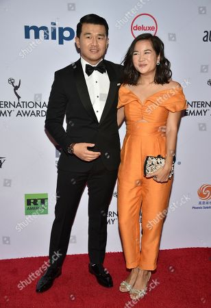 Ronny Chieng, Hannah Pham. Ronny Chieng, left, and Hannah Pham arrive at the 47th International Emmy Awards gala at the Hilton Hotel, in New York