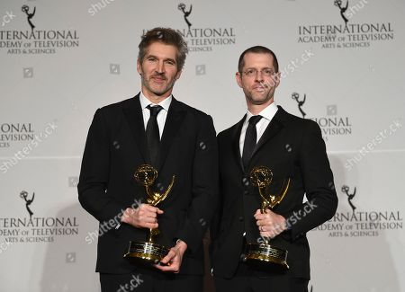 David Benioff, D.B. Weiss. The founders award recipients, David Benioff, left, and D.B. Weiss, pose with their awards during the 47th International Emmy Awards gala at the Hilton New York, in New York