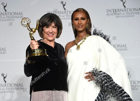 Christiane Amanpour, Iman. CNN International News anchor and directorate award recipient Christiane Amanpour poses with her award and presenter Iman during the 47th International Emmy Awards gala at the Hilton New York, in New York