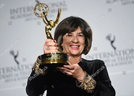 CNN International News anchor and directorate award recipient Christiane Amanpour poses with her award during the 47th International Emmy Awards gala at the Hilton New York, in New York