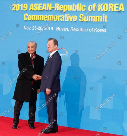 South Korean President Moon Jae-in (R) shakes hands with Malaysian Prime Minister Mahathir bin Mohamad (L) before the first session of the ASEAN-South Korea Commemorative Summit in Busan, South Korea, 26 November 2019. South Korean is hosting the Association of South East Asia Nations (ASEAN) Summit which will run 25 November to 26 November in Busan.