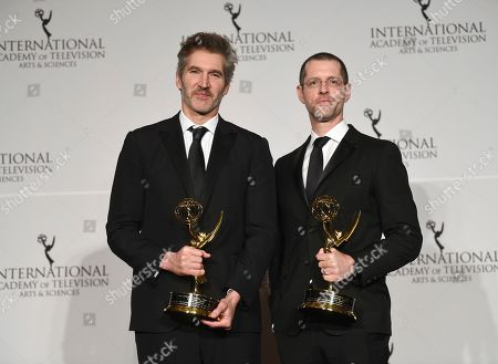 David Benioff, D.B. Weiss. The founders award recipients David Benioff, left, and D.B. Weiss pose with their awards during the 47th International Emmy Awards gala at the Hilton New York, in New York