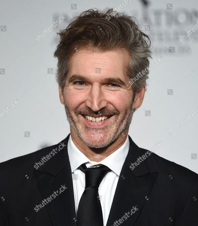 The founders award recipient David Benioff poses in the press room during the 47th International Emmy Awards gala at the Hilton New York, in New York