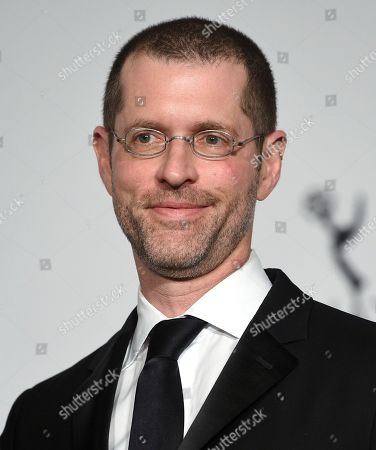 Stock Picture of The founders award recipient D.B. Weiss poses in the press room during the 47th International Emmy Awards gala at the Hilton New York, in New York