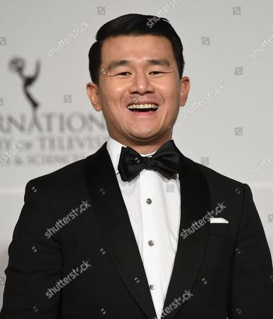 Host Ronny Chieng poses in the press room during the 47th International Emmy Awards gala at the Hilton New York, in New York