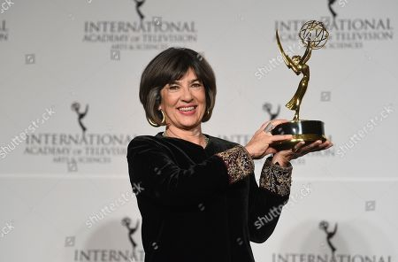 CNN International News anchor and the directorate award recipient Christiane Amanpour poses with her award during the 47th International Emmy Awards gala at the Hilton New York, in New York