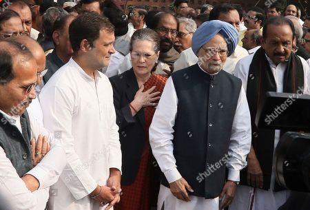 Congress party President Sonia Gandhi, center, stand with Rahul Gandhi. second left, and former prime minister Manmohan Singh, second right, during a protest by members of the opposition in parliament protest beside the statue of B.R. Ambedkar in New Delhi, India, . Members of the opposition boycotted Prime Minister Narendra Modi's speech in parliament on Constitution Day and protested beside the statue of Ambedkar, the freedom fighter who is also regarded as the architect of the constitution