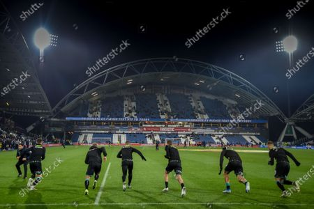 Stock Picture of Swansea City players warm up at the John Smith Stadium.