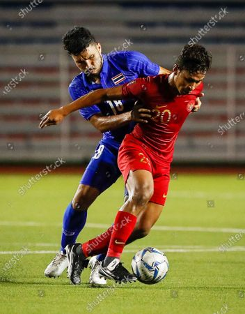 Osvaldo Ardiles Haay (R) of Indonesia in action against Kritsada Kaman (L) of Thailand during the SEA Games 2019 men's first round soccer match between Thailand and Indonesia in Manila, Philippines, 26 November 2019.