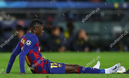 Ousmane Dembele of Barcelona goes down injured