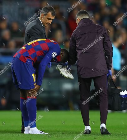 Ousmane Dembele of Barcelona shows a look of dejection as he is forced off through injury