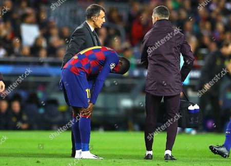 A tearful Ousmane Dembele of FC Barcelona is forced off with an injury