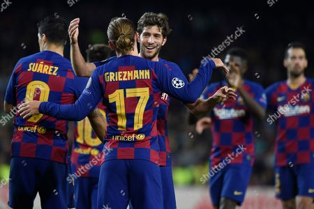 Antoine Griezmann of FC Barcelona celebrates with his teammate Sergi Roberto after scoring the 3-0