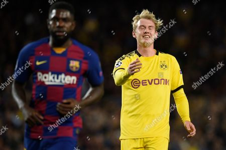 Julian Brandt of Borussia Dortmund and Samuel Umtiti of FC Barcelona