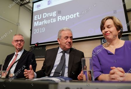 (L-R) Alexis Goosdeel, the Director of European Monitoring Centre for Drugs and Drug Addiction (EMCDDA), European Union (EU) Commissioner for Migration and Home Affairs Dimitris Avramopoulos, and Catherine De Bolle, the Europol managing Director, give a press conference to present the European Drug Markets Report 2019, in Brussels, Belgium, 26 November 2019.
