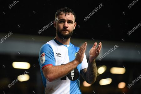 Stock Photo of 27th November 2019, Ewood Park, Blackburn, England; Sky Bet Championship, Blackburn Rovers v Brentford : Adam Armstrong (7) of Blackburn Rovers applauds the home supporters after he is substitutedCredit: Simon Whitehead/News Images