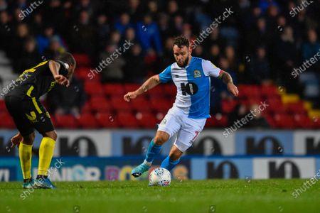 27th November 2019, Ewood Park, Blackburn, England; Sky Bet Championship, Blackburn Rovers v Brentford : Adam Armstrong (7) of Blackburn Rovers takes on a Brentford defenderCredit: Simon Whitehead/News Images