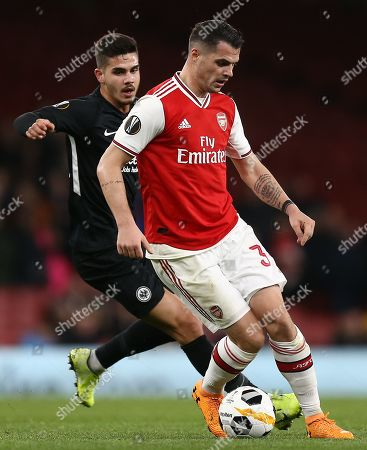 Stock Image of Granit Xhaka of Arsenal and Andre Silva of Eintracht Frankfurt