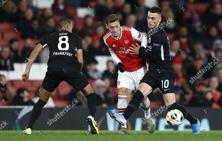 Mesut Ozil of Arsenal battles with Filip Kostic of Eintracht Frankfurt