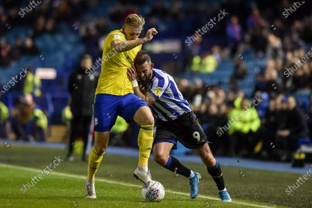 27th November 2019, Hillsborough, Sheffield, England; Sky Bet Championship, Sheffield Wednesday v Birmingham City :Marc Roberts (4) of Birmingham City and Steven Fletcher (9) of Sheffield Wednesday challenge for the ball.