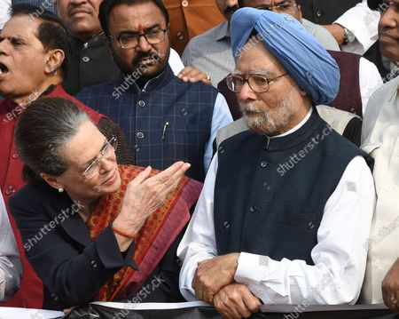 Indian congress party President Sonia Gandhi (L) and former Indian prime minister Manmohan Singh (R) stand during a protest by opposition members near the statue of Babasaheb Ambedkar, the architect of the Indian constitution, at parliament house in New Delhi, India, 26 November 2019. Members of the opposition boycotted the address given by Indian Prime Minster Narendra Modi and the unfolding situation of politics in Maharashtra.