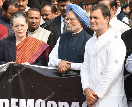 Indian congress party President Sonia Gandhi (L), Rahul Gandhi (L) and former Indian prime minister Manmohan Singh (C) stand during a protest by opposition members near the statue of Babasaheb Ambedkar, the architect of the Indian constitution, at parliament house in New Delhi, India, 26 November 2019. Members of the opposition boycotted the address given by Indian Prime Minster Narendra Modi and the unfolding situation of politics in Maharashtra.