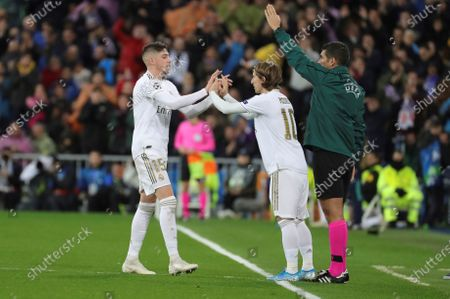 Real Madrid's Fede Valverde (L) is substituted by Luka Modric (C) during the UEFA Champions League group A soccer match between Real Madrid and Paris Saint-Germain at Santiago Bernabeu in Madrid, Spain, 26 November 2019.