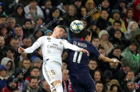 Real Madrid's Fede Valverde (L) in action against PSG's Angel Di Maria (R) during the UEFA Champions League group A soccer match between Real Madrid and Paris Saint-Germain at Santiago Bernabeu in Madrid, Spain, 26 November 2019.