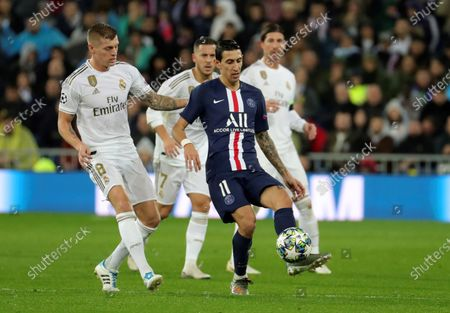 Real Madrid's Toni Kroos (L) in action against PSG's Angel Di Maria (R) during the UEFA Champions League group A soccer match between Real Madrid and Paris Saint-Germain at Santiago Bernabeu in Madrid, Spain, 26 November 2019.