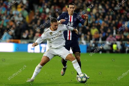 Real Madrid's Eden Hazard (L) in action against PSG's Angel Di Maria (R) during the UEFA Champions League group A soccer match between Real Madrid and Paris Saint-Germain at Santiago Bernabeu in Madrid, Spain, 26 November 2019.
