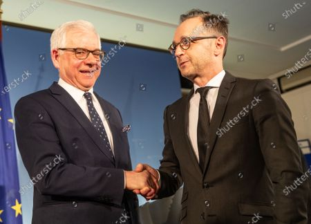 Polish Foreign Minister Jacek Czaputowicz (L) and German Foreign Minister Heiko Maas (R) shake hands following a joint press conference at the German Foreign Ministry in Berlin, Germany 26 November 2019.