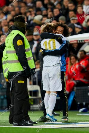 Luka Modric and Marcelo Vieira of Real Madrid celebrate a goal