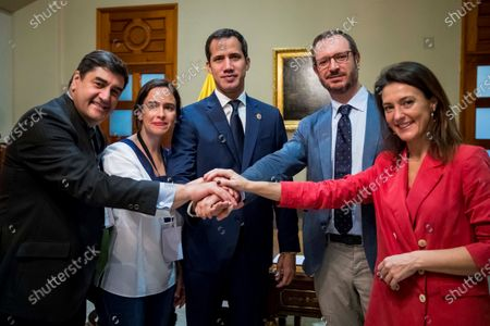 President of the Venezuelan Parliament, Juan Guaido (C), holds a meeting with spokesman for the PP in the Senate Javier Maroto, deputy spokesman of the PP in Congress Jose Ignacio Echaniz, secretary of International Relations of the PP Valentina Martinez and President of the National Electoral Committee of the PP Belen Hoyo before attending the event 'World parliamentary meeting for democracy', in the Federal Legislative Palace of the National Assembly of Venezuela, in Caracas, Venezuela, 26 November 2019.
