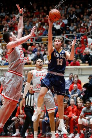 Stock Photo of Kent State guard Mitch Peterson, right, goes up for a shot in front of Ohio State guard Duane Washington, center, and forward Kyle Young during an NCAA college basketball game in Columbus, Ohio, . Ohio State won 71-52