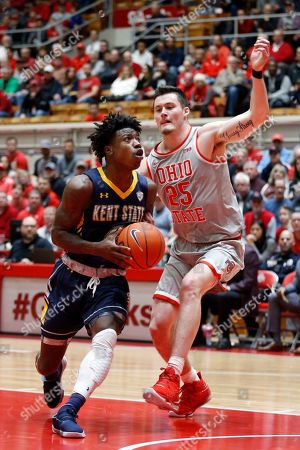 Kent State guard Antonio Williams, left, drives in front of Ohio State forward Kyle Young during an NCAA college basketball game in Columbus, Ohio, . Ohio State won 71-52