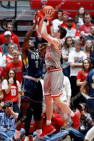 Stock Picture of Ohio State forward Kyle Young, right, goes up for a shot over Kent State forward Danny Pippen during an NCAA college basketball game in Columbus, Ohio, . Ohio State won 71-52