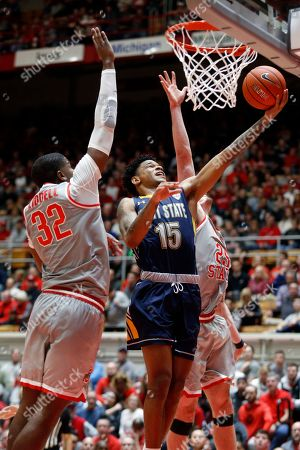 Kent State guard Anthony Roberts, center, goes up for shot between Ohio State forward E.J. Liddell, left, and forward Kyle Young during an NCAA college basketball game in Columbus, Ohio, . Ohio State won 71-52