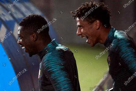 FC Barcelona's forward Ousmane Dembele (L) and midfielder Jean-Clair Todibo (R) attend a team's training session at Joan Gamper sport city in Barcelona, Catalonia, northeastern Spain, 26 November 2019. FC Barcelona will face Borussia Dortmund in a UEFA Champions League's group F soccer match at Camp Nou on 27 November.
