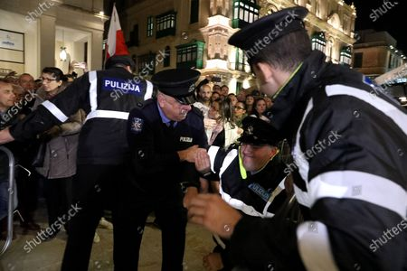 An injured policeman as demonstrators protest outside Malta's House of Parliament in Valletta, Malta, 26 November 2019 following the resignations of Minister Konrad Mizzi and Prime Minister Joseph Muscat's Head of Staff Keith Schembri and  Minister Chris Cardona suspending himself from any activities of his party (Partit Laburista) as Malta police investigations into the murder of late journalist Daphne Caruana Galizia in 2017 continue.
