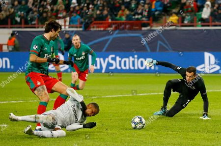 Leverkusen's Leon Bailey falls down as he struggles with Lokomotiv's Vedran Corluka for the ball during the Champions League Group D soccer match between Lokomotiv Moscow and Leverkusen at the Lokomotiv Stadium in Moscow, Russia