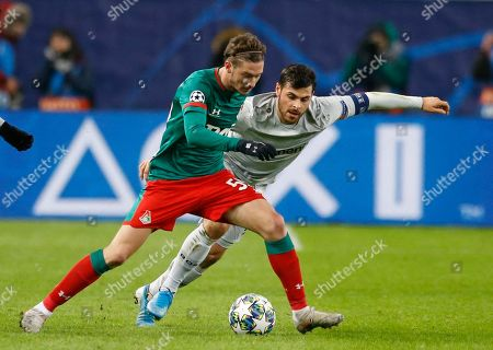Lokomotiv's Aleksei Miranchuk, left, and Leverkusen's Kevin Volland challenge for the ball during the Champions League Group D soccer match between Lokomotiv Moscow and Leverkusen at the Lokomotiv Stadium in Moscow, Russia