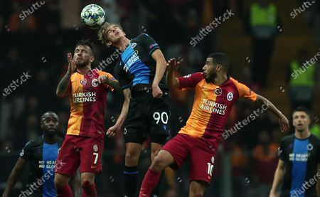 Club Brugge's Charles De Ketelaere (C) in action Galatasaray's Adem Buyuk (L) and Younes Belhanda (R) during the UEFA Champions League group A soccer match between Galatasaray and Club Brugge in Istanbul, Turkey, 26 November 2019.