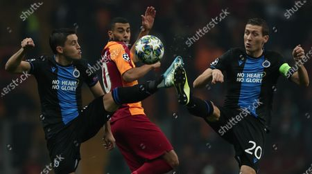 Club Brugge's Hans Vanaken (R) and Federico Ricca (L) in action Galatasaray's Younes Belhanda (C) during the UEFA Champions League group A soccer match between Galatasaray and Club Brugge in Istanbul, Turkey, 26 November 2019.