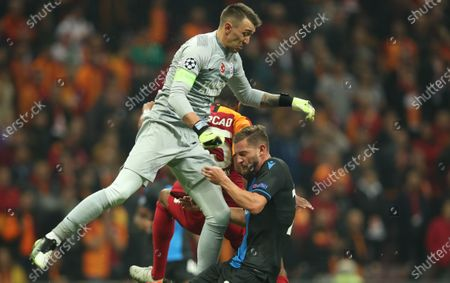 Stock Picture of Club Brugge's Mats Rits (R) in action against Galatasaray's Fernando Muslera (L) during the UEFA Champions League group A soccer match between Galatasaray and Club Brugge in Istanbul, Turkey, 26 November 2019.