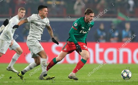 Lokomotiv's Aleksei Miranchuk, right, fights for the ball with Leverkusen's Charles Aranguiz during the Champions League Group D soccer match between Lokomotiv Moscow and Leverkusen at the Lokomotiv Stadium in Moscow, Russia