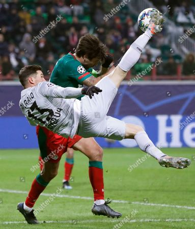 Leverkusen's Lucas Alario, front, fights for the ball with Lokomotiv's Vedran Corluka during the Champions League Group D soccer match between Lokomotiv Moscow and Leverkusen at the Lokomotiv Stadium in Moscow, Russia