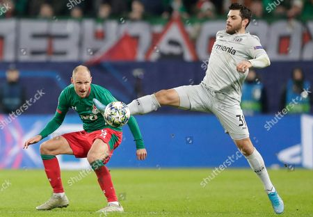 Stock Image of Leverkusen's Kevin Volland, right, fights for the ball with Lokomotiv's Benedikt Hoewedes during the Champions League Group D soccer match between Lokomotiv Moscow and Leverkusen at the Lokomotiv Stadium in Moscow, Russia