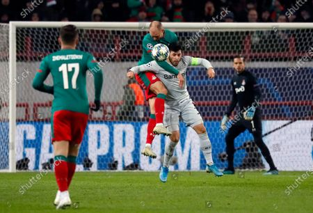Benedikt Howedes (C-L) in action against Kevin Volland (C-R) during the UEFA Champions League Group D soccer match between Lokomotiv Moscow and Bayer Leverkusen in Moscow, Russia, 26 November 2019.